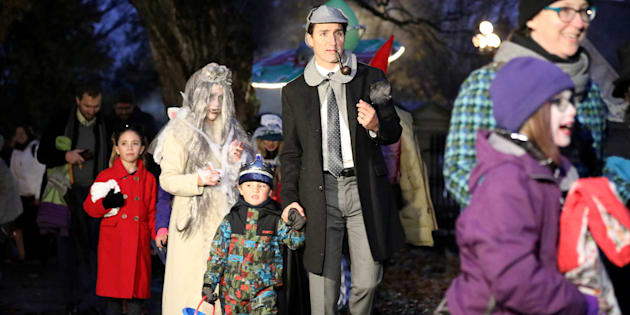Prime Minister Justin Trudeau walks with his son Hadrien while participating in Halloween festivities with his family at Rideau Hall in Ottawa on Wednesday.