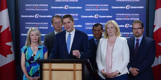Conservative Leader Andrew Scheer makes an announcement with MPs Candice Bergen, Chris Warkentin, Alain Rayes, Lisa Raitt, and Mark Strahl at the National Press Theatre in Ottawa on July 20, 2017.