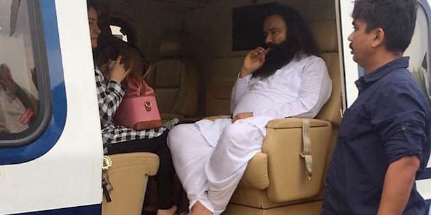 Panchkula: Dera Sacha Sauda chief Gurmeet Ram Rahim  in a helicopter in which he was flown from Panchkula to Rohtak town to lodged in jail on Friday. PTI Photo(PTI8_25_2017_000234B)