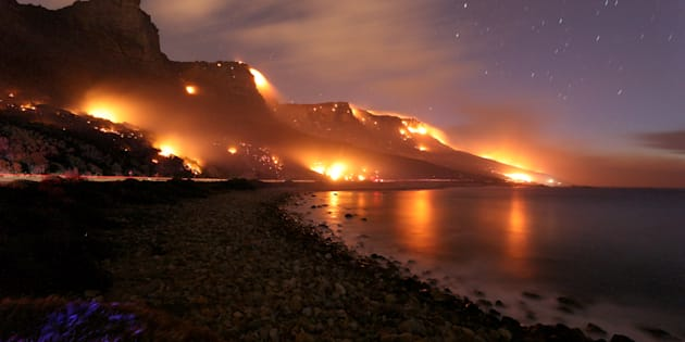 Wildfires burn along the Twelve Apostles area of Table Mountain in Cape Town, South Africa, October 13, 2017.