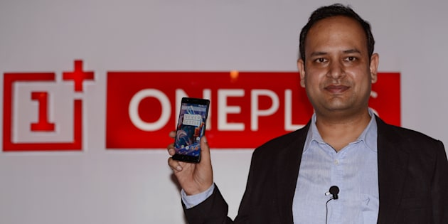 Vikas Agarwal, General Manager for Indian of the OnePlus cellphone company holds a newly-launched OnePlus 3 mobile at an event in New Delhi on June 15, 2016.