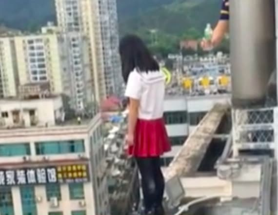 Principal stops student from jumping off building