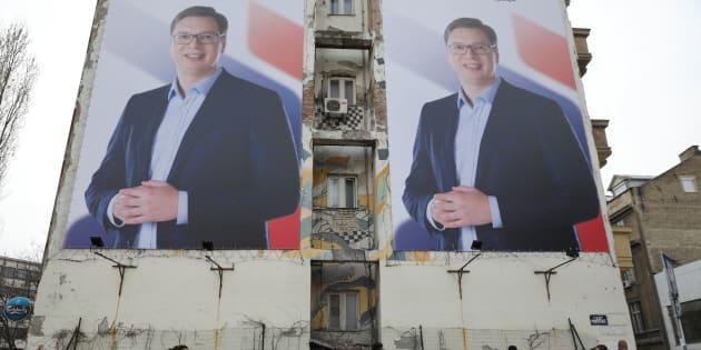 People pass posters of Serbian prime minister Aleksandar Vucic, in Novi Sad, Serbia March 18, 2017.