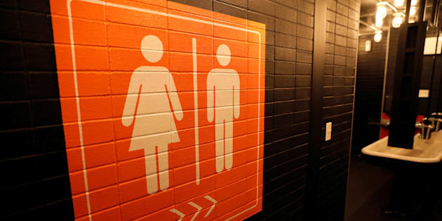 A sign is seen pointing to a gender neutral restroom in New York City, U.S., April 19, 2017.