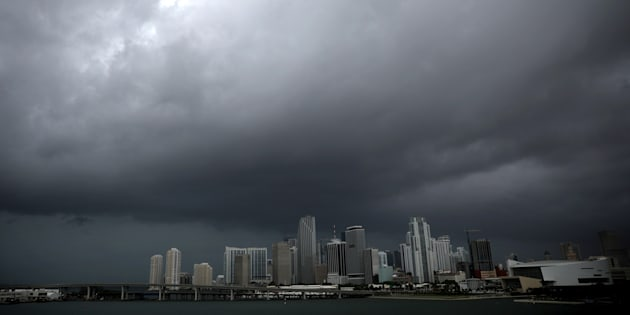 Dark clouds are seen over Miami's skyline prior to the arrival of Hurricane Irma to south Florida, U.S. September 9, 2017. REUTERS/Carlos Barria