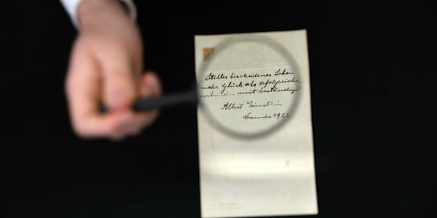 A note written on a Tokyo hotel official paper in 1922 by Albert Einstein is seen before it is sold at an auction in Jerusalem, October 24, 2017. REUTERS/Ammar Awad