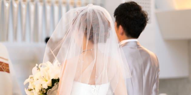 Happy bride and groom walking on virgin load