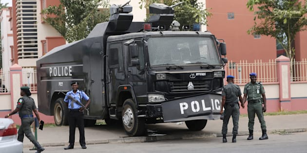 REUTERS  Afolabi Sotunde                       Policemen stand next to a water cannon truck in Abuja Nigeria