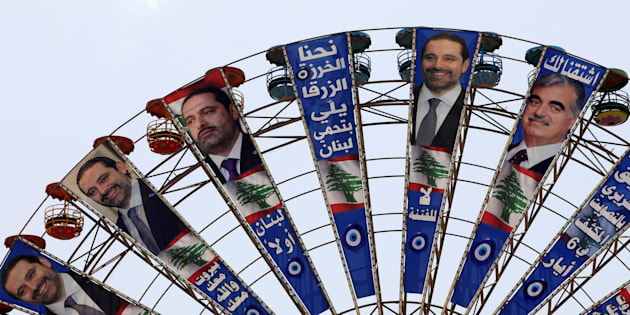Campaign posters of Lebanese Prime Minister and candidate for parliamentary elections Saad al-Hariri and his father, assassinated Prime Minister Rafik al-Hariri, hang on Ferris Wheel in Beirut, Lebanon May 3, 2018. Reuters/Jamal Saidi