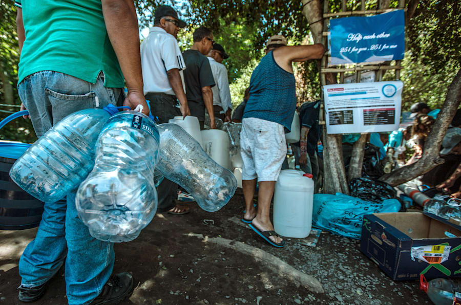 Cape Town residents queue to refill water bottles at Newlands Spring on January 31, 2018.