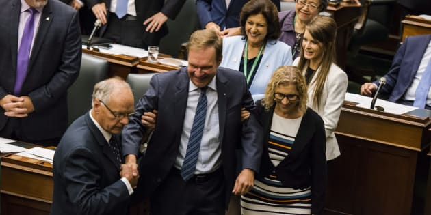 Ted Arnott is carried by fellow MPPs after his election as the new Speaker of the Ontario Legislative Assembly at Queen's Park in Toronto on July 11, 2018.