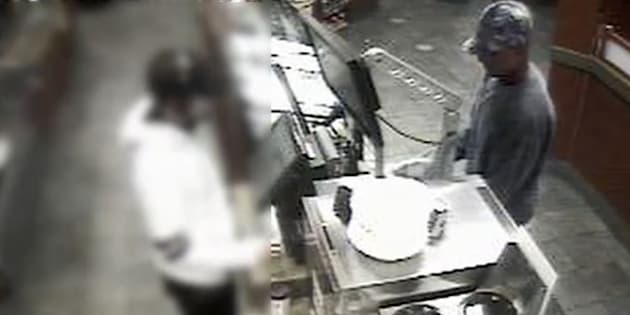 A screengrab from security footage showing a robbery at a Tim Hortons location in Windsor, Ont.
