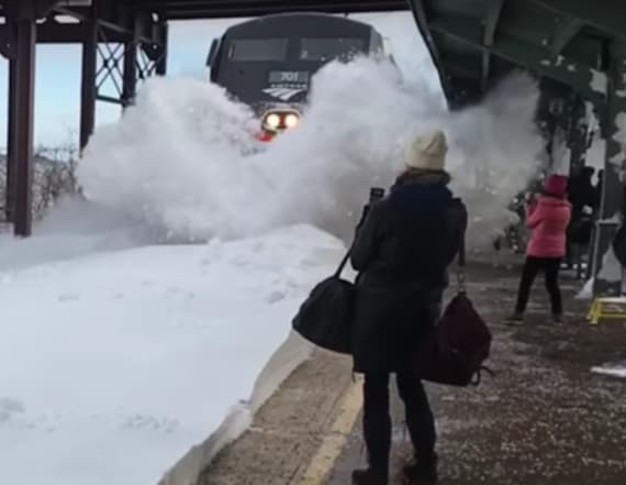 Train blasts commuters with wave of snow