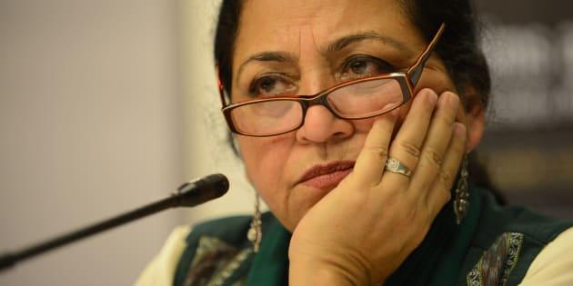 Indian author Madhu Kishwar looks on as she addresses media representatives in Ahmedabad.