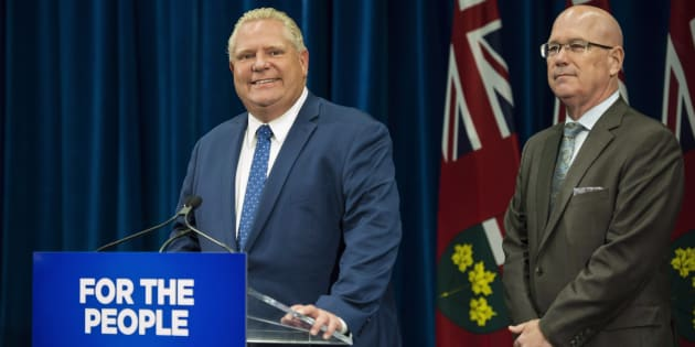 Ontario Premier Doug Ford speaks to reporters with MPP Steve Clark, Minister of Municipal Affairs and Housing, in Toronto, on Sept. 10, 2018.