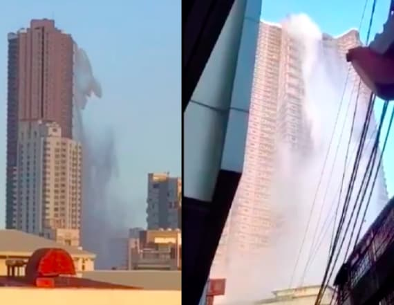 Footage shows water cascading from penthouse pool