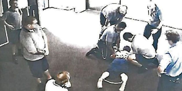 The images show a boy being restrained, stripped and thrown into isolation.