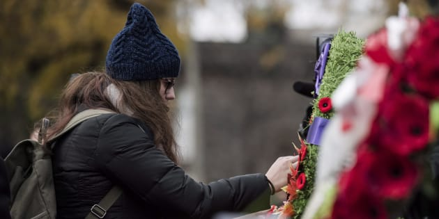 A woman pays her respects at a Remembrance Day ceremony.