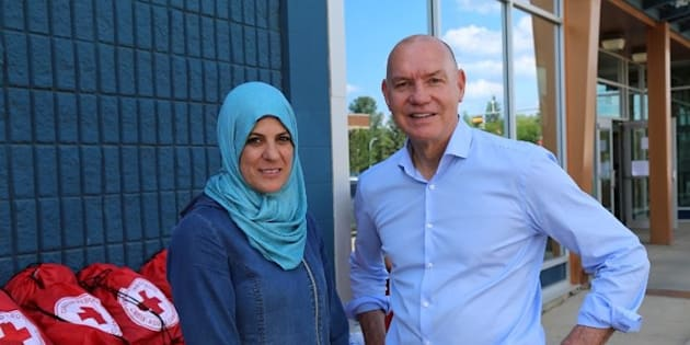 Canadian Red Cross President and CEO Conrad Sauvé with Fort McMurray resident and small business owner Rewaida Assaf.