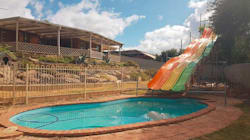 This Tradie Built A Twelve Metre Long Water Slide. Now The Council Wants It