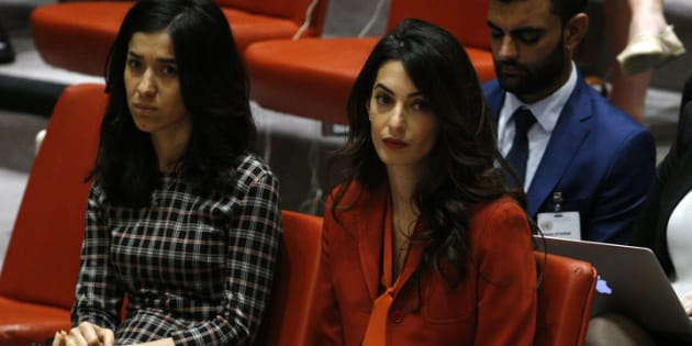 Activist Amal Clooney (R) attends a United Nations Security Council meeting set to adopt a resolution to help preserve evidence of Islamic State crimes in Iraq, during the 72nd United Nations General Assembly at U.N. Headquarters in New York, U.S., September 21, 2017. REUTERS/Brendan Mcdermid