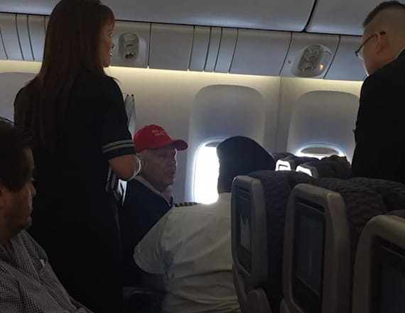 United passenger wearing Trump hat causes disruption