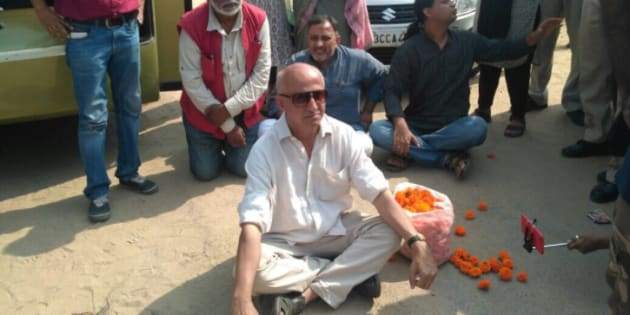 Author and activist Harsh Mander, along with other Karwan-e-Mohabbat activists, sits in a dharna at the spot where Pehlu Khan was killed.