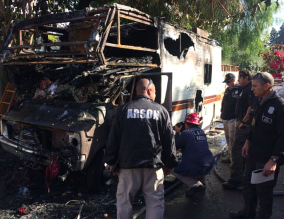 Man dies trying to rescue dogs from burning RV