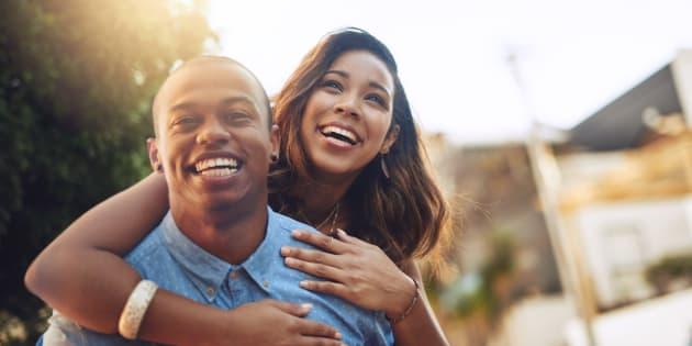 Shot of a happy young couple enjoying a piggyback ride outdoors