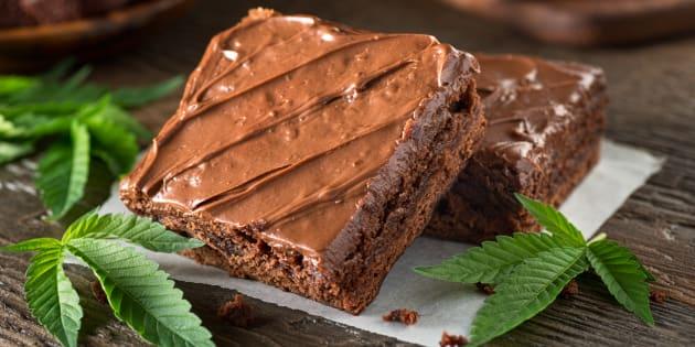 Homemade pot brownies with marijuana leaf garnish.