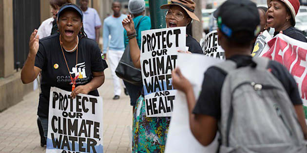 Activists demonstrate outside the court during the hearing on the Thabametsi coal-fired power station.