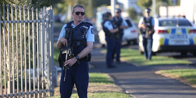 Armed police guard the Masijd Ayesha Mosque Auckland, New Zealand on March 15, 2019 following two shootings at mosques in Christchurch.