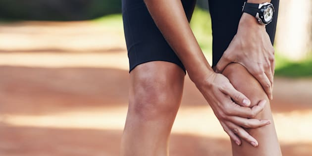 Cropped shot of a runner holding onto her injured kneehttp://195.154.178.81/DATA/i_collage/pi/shoots/805758.jpg