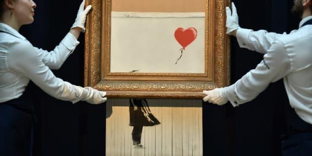"""La toile """"Girl with Balloon"""" de Banksy lors de son autodestruction partielle chez Sotheby's à Londres, le 5 octobre dernier."""