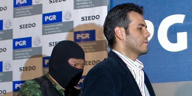 "Jesus Vicente Zambada-Niebla, a son of fugitive Mexican cartel leader Ismael ""El Mayo"" Zambada Garcia, is presented to the press at the attorney general's office in Mexico City March 19, 2009"