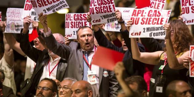 Des participants à la rencontre entre les bailleurs sociaux et le ministre du Logement, le 28 septembre 2017 à Strasbourg, manifestent leur mécontentement.