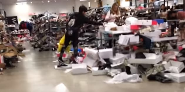 A screengrab from a YouTube video shows a chaotic scene at one of Sears Canada's stores during  liquidation.