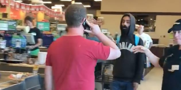 White man blocks person of color from leaving store in viral video
