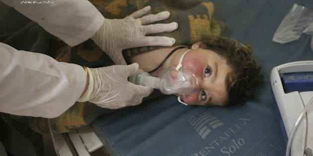 A Syrian doctor treats a child at a makeshift hospital in the town of Khan Sheikhoun northern Idlib province, Syria.