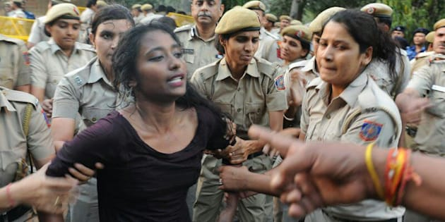 Police drag Dipsita Dhar away.