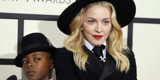 Madonna and her son, David Ritchie, arrive at the 56th annual Grammy Awards in Los Angeles, California January 26, 2014.