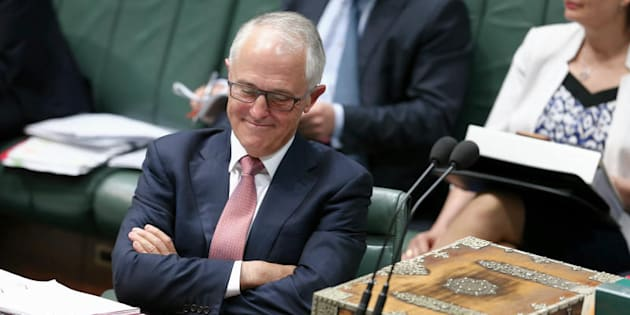 """Malcolm Turnbull resumes his seat after expressing """"full confidence"""" in the Attorney-General George Brandis"""