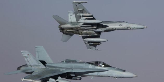 Two of the RAAF's Air Task Group's (ATG) F/A-18A Hornets