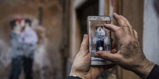 23/03/2018 Roma, lo street artist TVBOY realizza dei poster nel centro di Roma. Nella foto il  poster dedicato a Matteo Salvini e Luigi Di Maio che si baciano