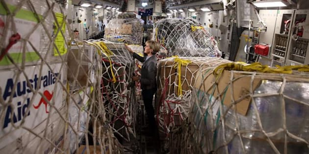 Foreign Affairs Minister Julie Bishop inspects Australian aid supplies.
