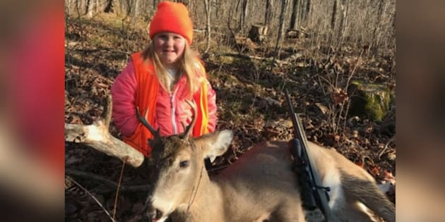 Six-year-old Lexie Harris is one of the youngest shooters to bag a buck after U.S. state Wisconsin scrapped its minimum hunting age.