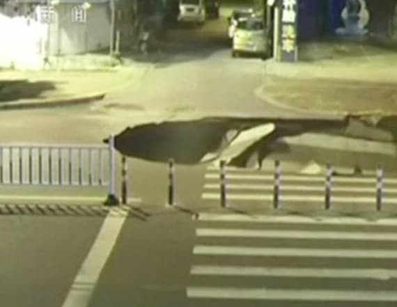 Man distracted by phone falls into giant sinkhole