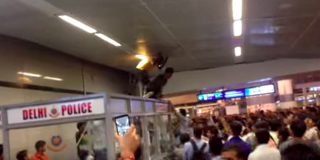 Screen grab of a video showing how three men from Africa were beaten up mercilessly in Rajiv Chowk metro station in September 2014.