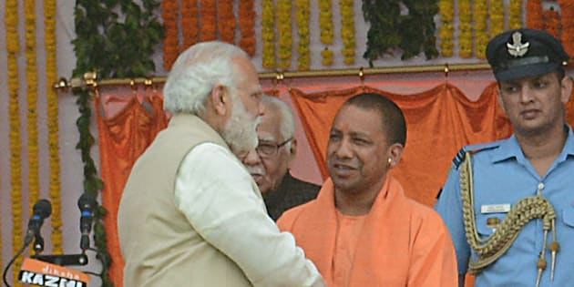 UP CM Yogi Adityanath and Prime Minister Narendra Modi with other party leaders during the swearing-in ceremony at Lucknow's sprawling Smriti Upvan complex, on March 19, 2017 in Lucknow, India.