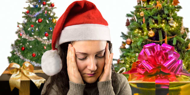 close up of a woman with headache at Christmas